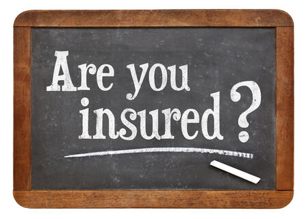 personal injury: are you insured question on a vintage slate blackboard