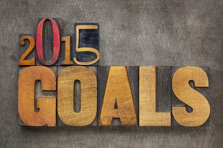 2015 goals - New Year resolution concept - text in vintage letterpress wood type blocks against grunge metal photo