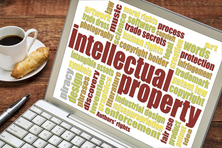 trade secret: intellectual property word cloud on digital tablet with a cup of coffee Stock Photo