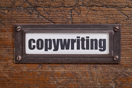 copywriting: copywriting  - file cabinet label, bronze holder against grunge and scratched wood