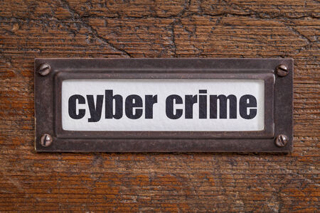 cyber crime: cyber crime - file cabinet label, bronze holder against grunge and scratched wood