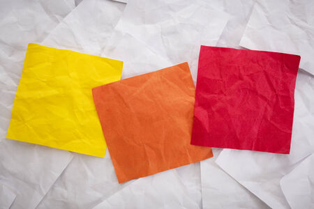 three blank colorful crumpled sticky notes read for your text