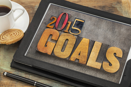 2015 goals - New Year resolution concept - text in vintage letterpress wood type on a digital tablet screen photo