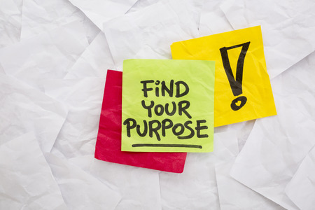 find your purpose - reminder or advice handwritten on colorful sticky notes