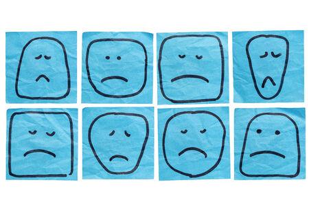 caras tristes: un conjunto de caras tristes e infelices - bocetos en aislados azul notas adhesivas