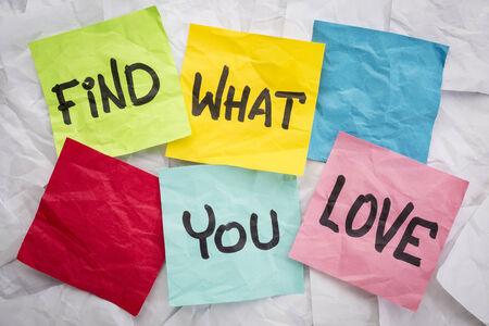 finding love: find what you love - reminder or advice handwritten on colorful sticky notes Stock Photo