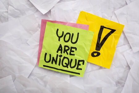 you are unique -  a motivational  reminder handwritten on colorful sticky notes Banco de Imagens