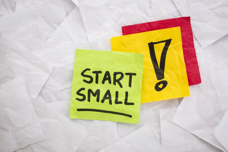 start small  - reminder or advice handwritten on colorful sticky notes Stok Fotoğraf