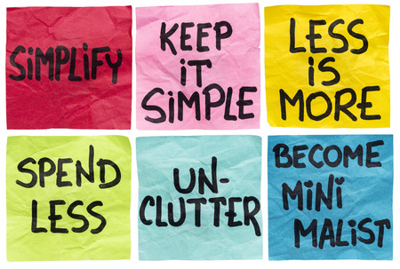simplify, keep it simple, less id more, spend less, unclutter, become minimalist - a set of isolated crumpled sticky notes with handwritten advice and reminders Banco de Imagens - 31039088