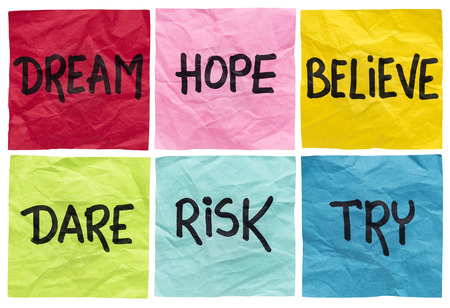 dream, hope, believe, dare, risk, try - motivational concept - a set of isolated crumpled sticky notes with handwritten advice and reminders Stock Photo