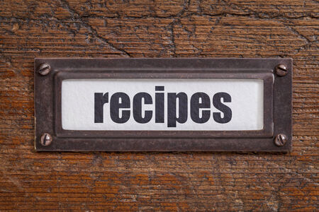 recipes word - file cabinet label, bronze holder against grunge and scratched wood