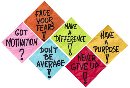 face your fears, make a difference, don't be average, never give up, have a purpose - motivation reminders -  a set of isolated crumpled sticky notes in different colors Stockfoto
