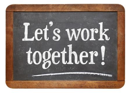 lets work together - teamwork concept  on a vintage slate blackboard Stock Photo