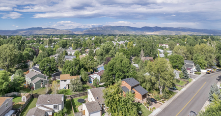 horsetooth rock: aerial panorama of residential area in Fort Collins, Colorado, with foothills of Rocky Mountains and Horsetooth Rock in background, late summer