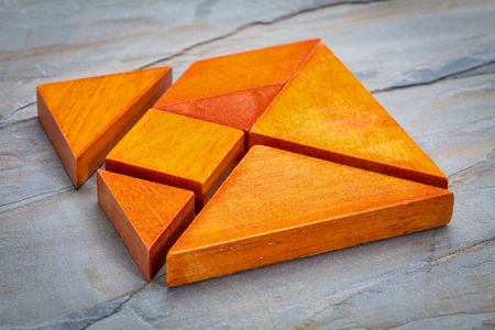 tangram: seven tangram wooden pieces, a traditional Chinese puzzle game, slate rock