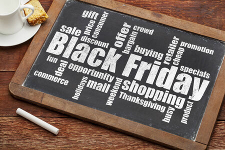 Black Friday shopping word cloud on a vintage slate blackboard with a cup of coffee Stock fotó