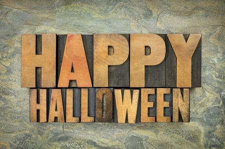 happy halloween typography - letterpress  wood type printing blocks against slate rock background photo