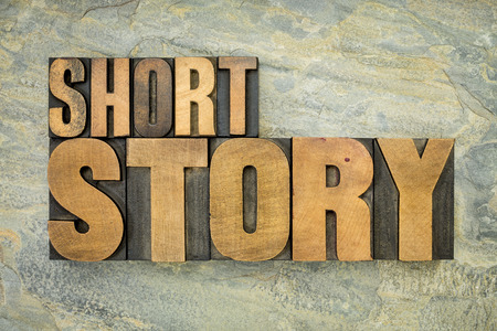 narration: short story - words in vintage letterpress wood type on a green slate rock background Stock Photo