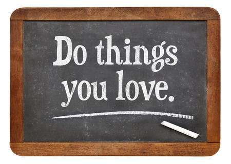 things to do: do things you love - motivational advice on a vintage slate blackboard