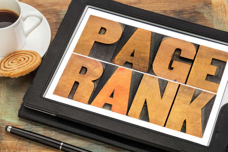 page rank: page rank text in vintage letterpress wood type on a digital tablet
