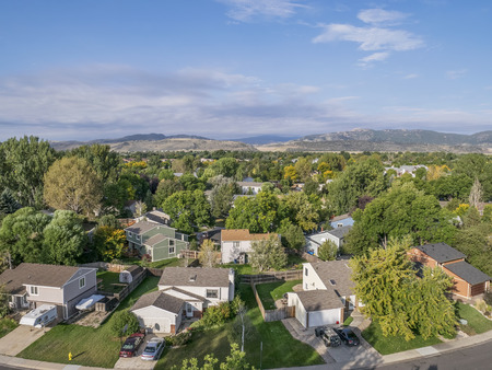 front range: FORT COLLINS, CO, USA - SEPTEMBER 21 2014: Aerial view of typical residential neighborhood along Front Range of Rocky Mountains in Colorado, late summer