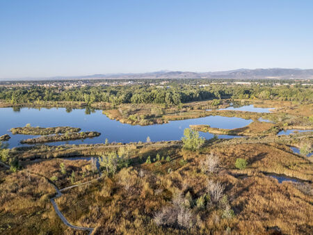 aerial view of Riverbend Ponds, one of natural areas in Fort Collins, Colorado along the Poudre River converted from gravel quarry