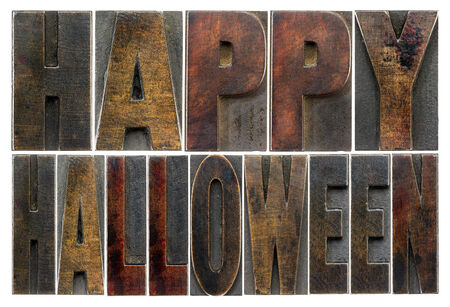 printing block block: Happy Halloween  -  isolated text in vintage grunge wood type printing blocks stained by color inks