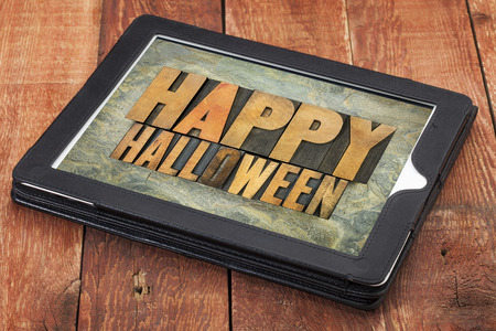 Happy Halloween typography - letterpress  wood type printing blocks on a digital tablet photo
