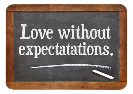 love without expectations - advice  words on a vintage slate blackboard