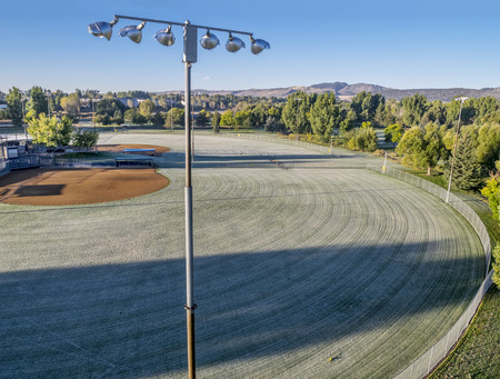 aerial view of empty baseball fields covered by frost  in Fort Collins, Colorado, early fall morning Stok Fotoğraf