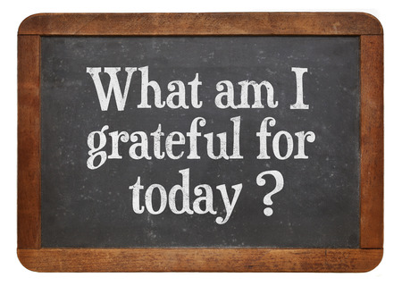 grateful: what am I grateful for today  - inspirational question on a vintage slate blackboard