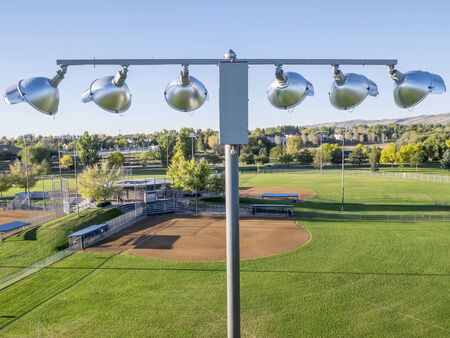 baseball fields and lights - aerial view from low flying drone, early fall morning in Fort Collins, Colorado
