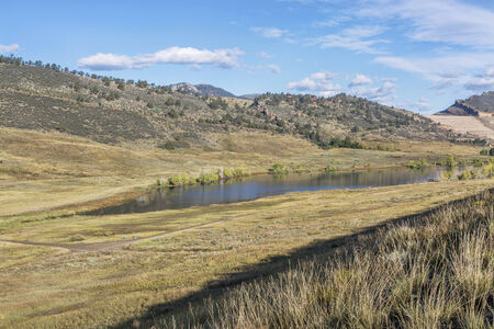 collins: mountain valley and lake - Pineridge Natural Area at Rocky Mountain foothills in Fort Collins, Colorado