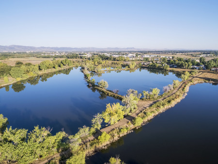 poudre river: aerial view of Riverbend Ponds, one of natural areas in Fort Collins, Colorado along the Poudre River converted from gravel quarry