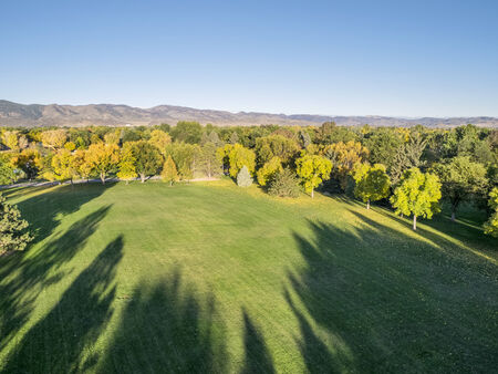 aerial view of park in fall colors under morning light with deep long shadows, Fort Collins, Colorado, Zdjęcie Seryjne