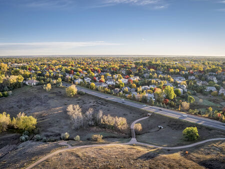 aerial view of residential area of Fort Collins, Colorado in fall colors, shot by a low flying drone from Cathy Fromme Prairie Natural Area Stock fotó