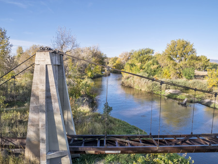 cache la poudre: aerial view of Cache la Poudre River and old irrigation aqueduct, fall scenery shot from low flying drone Stock Photo