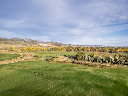 foothill: aerial view of a park, recreation soccer fields and bike trails at Rocky Mountains foothill, Fort Collins, Colorado
