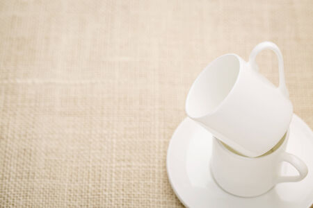 two empty stacked espresso coffee cups on a canvas, shallow depth of field Imagens