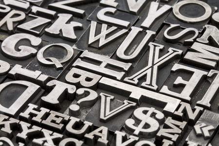 metal: metal type abstract - vintage letterpress printing blocks with letters, dollar sign and question mark Stock Photo