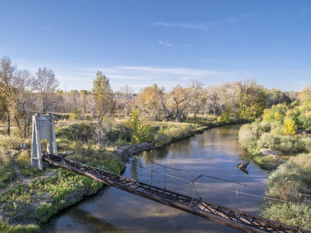 aerial view of Cache la Poudre River and old irrigation aqueduct, fall scenery shot from low flying drone Stock Photo