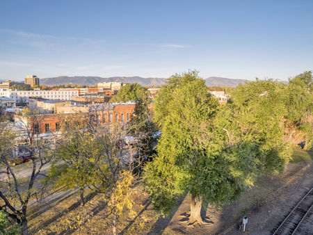 aerial view of Fort Collins downtown in sunrise light, shot from a low flying drone Sajtókép