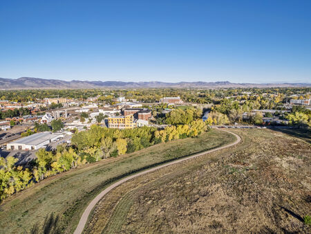 cache la poudre: aerial view of a bike trail along the Poudre River and Fort Collins downtown, Colorado Stock Photo