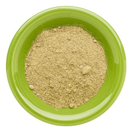 hemp: hemp protein powder  on an isolated green bowl Stock Photo