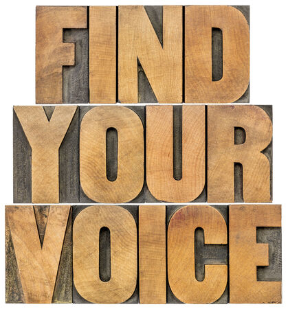 wood type: find your voice motivation concept - isolated text in letterpress wood type