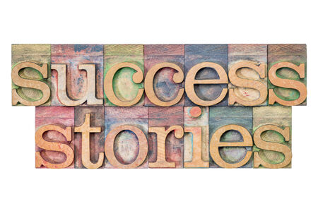 wood type: success stories - isolated text in letterpress wood type blocks stained by color inks Stock Photo