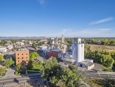 fort collins: FORT COLLINS, CO, USA - October 6, 2014: Aerial view of Fort Collins landmarks - historic Harmony Mill and Ranchway Feed grain elevator.