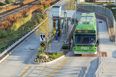 FORT COLLINS, CO, USA - SEPTEMBER 16 2014:  MAX bus at stop. MAX Bus Rapid Transit serves major activity and employment centers throughout Fort Collins including Midtown, CSU and Downtown