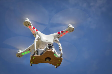 fort collins: FORT COLLINS, CO, USA, November 2, 2014:  Airborne radio controlled Phantom 2 quadcopter drone flying  with the Panasonic Lumix GM1 camera mounted on a home made platform.