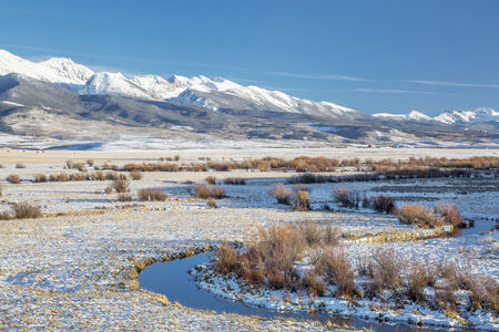meanders: meanders of Canadian River and Medicine Bow Mountains in North Park near Walden, Colorado